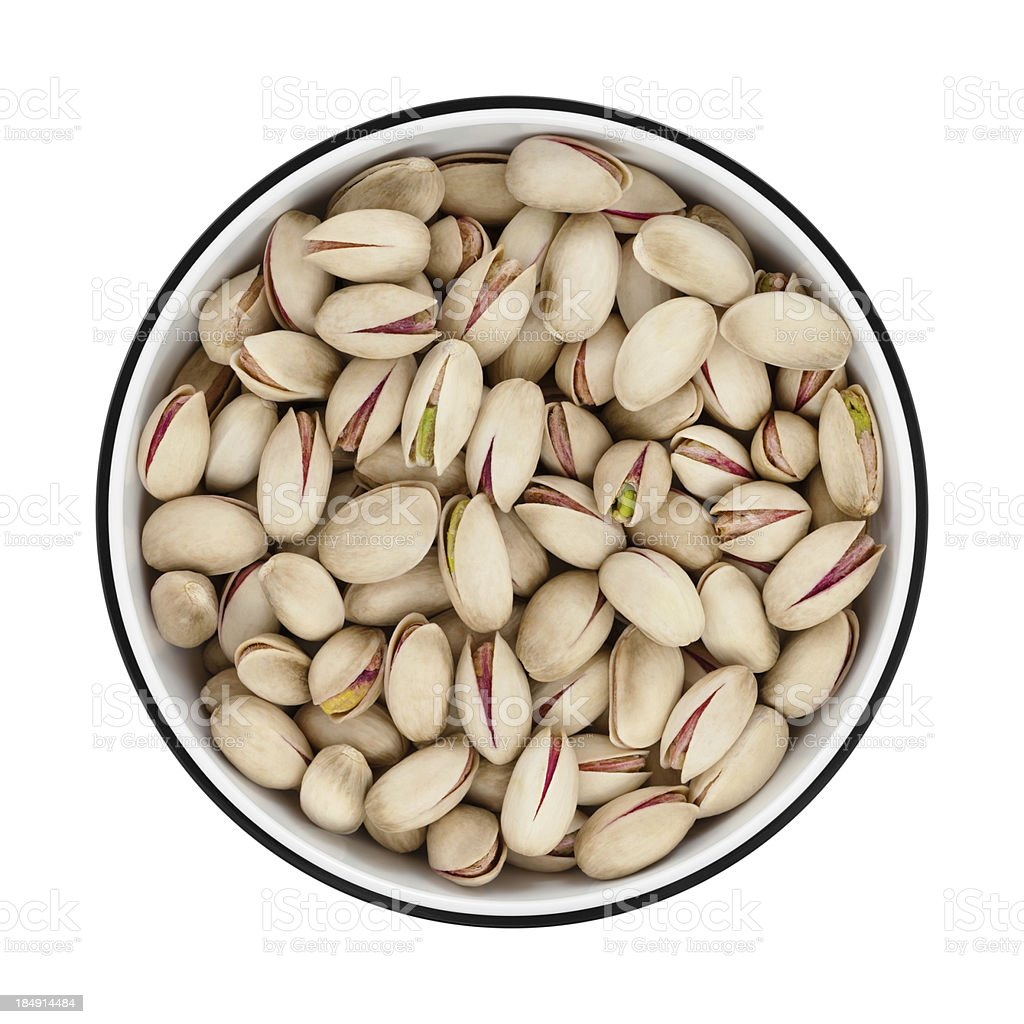 Pistachios in a bowl from directly above stock photo