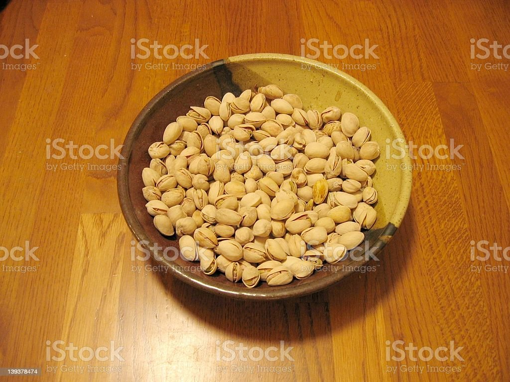 Pistachios in a ceramic bowl stock photo