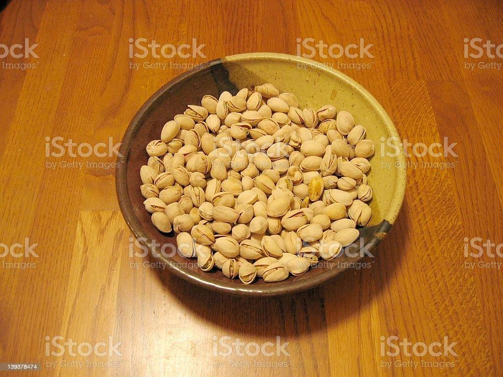 Pistachios in a ceramic bowl stock photo