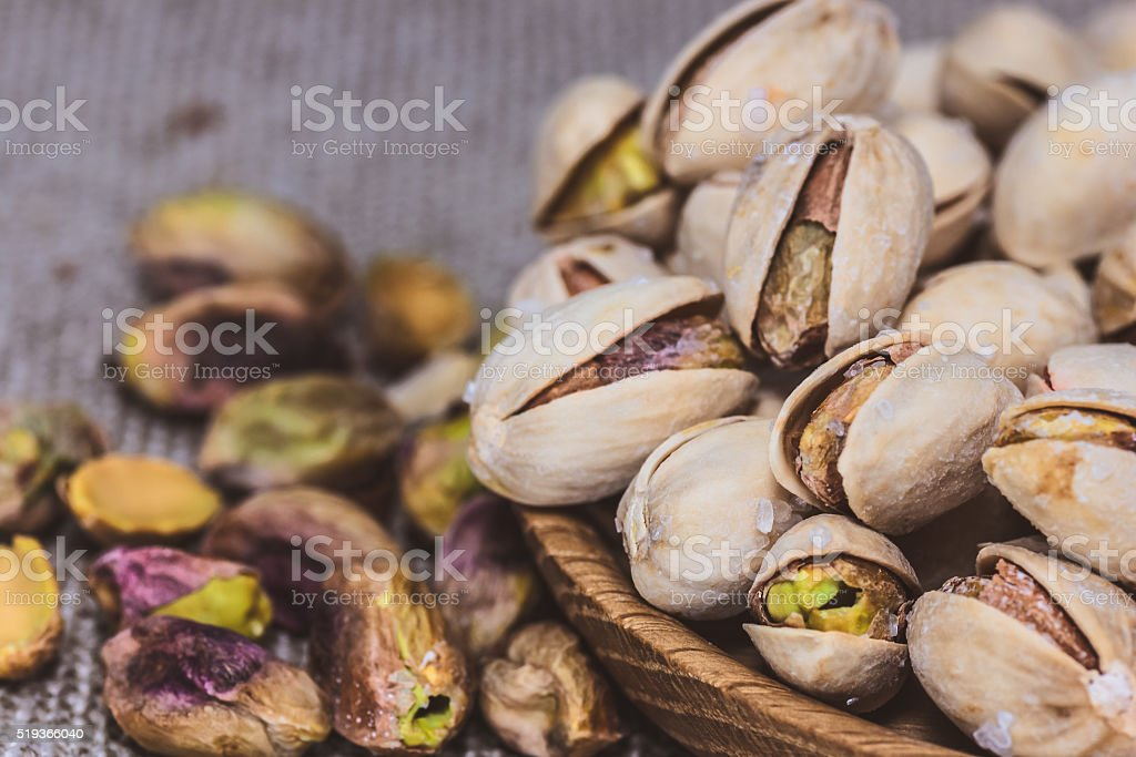 Pistachios in a wooden plate close healthy nutrition organic stock photo