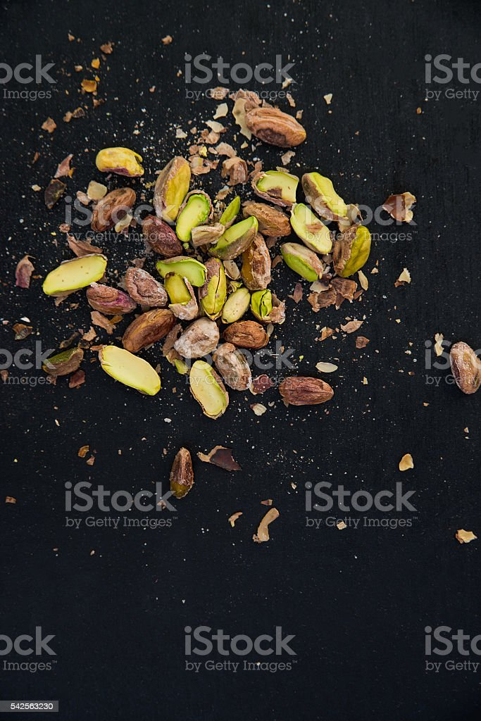 pistachios on black slate table stock photo