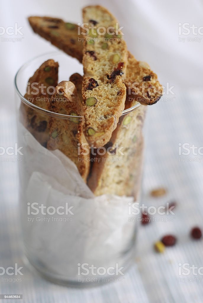 Pistachios, pine nuts and dried cranberries biscotti stock photo