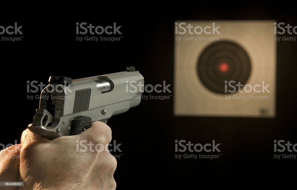 Pistol aiming at target royalty-free stock photo