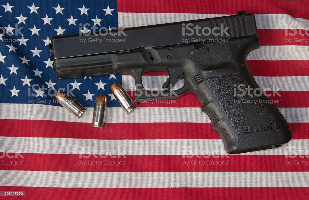 Pistol, ammo and the flag. stock photo