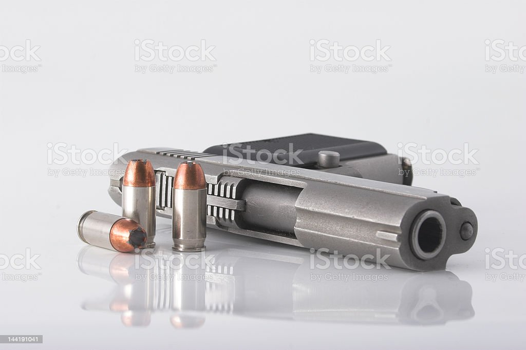 Pistol and bullets royalty-free stock photo