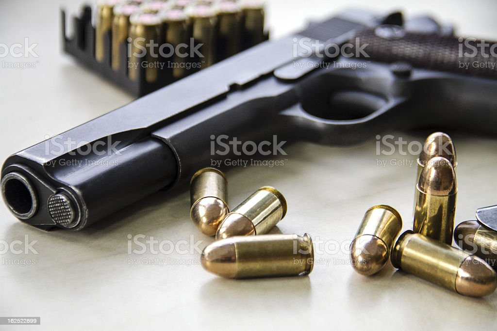 Pistol and bullets stock photo