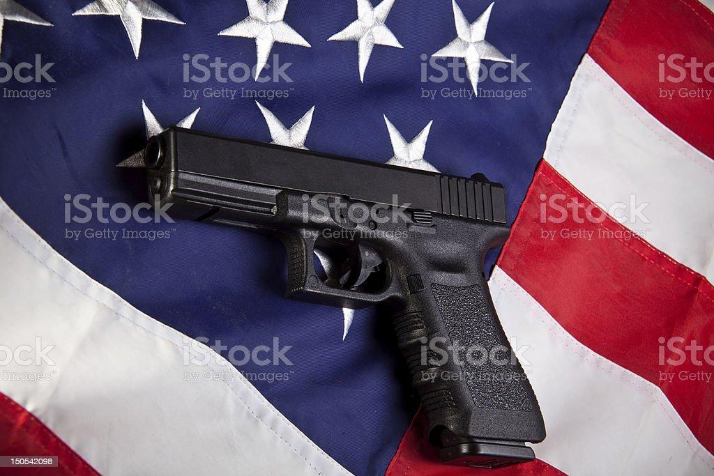Pistol and flag (horizontal) stock photo