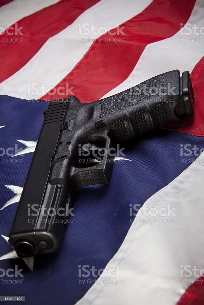 Pistol and flag (vertical) stock photo