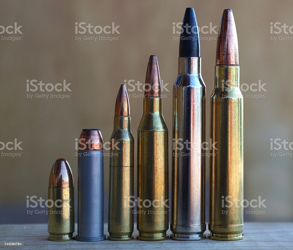 pistol and rifle bullets increasing in size stock photo