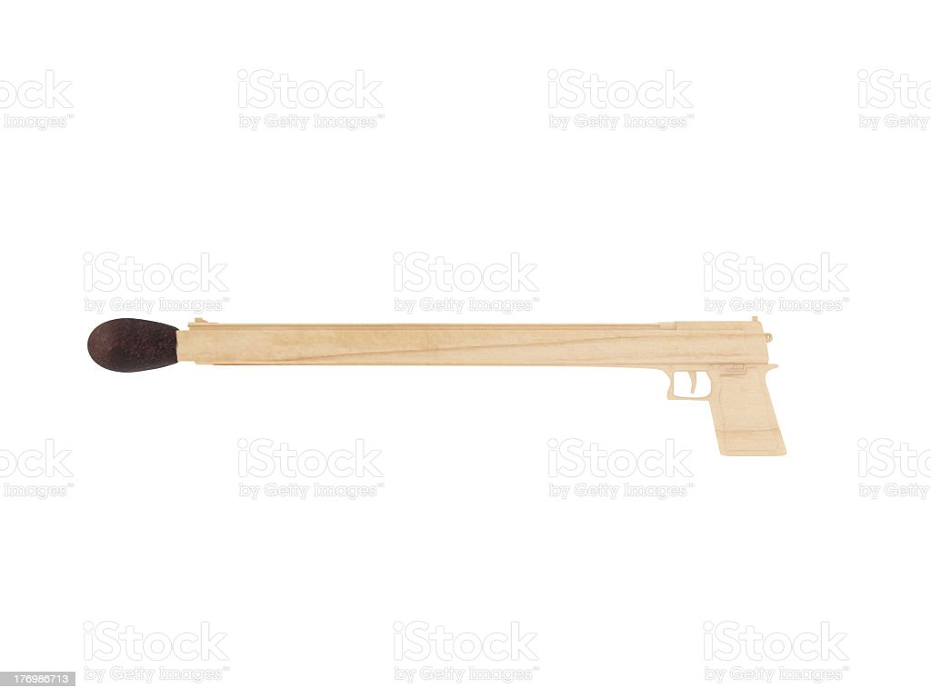 Pistol carved from matchsticks stock photo