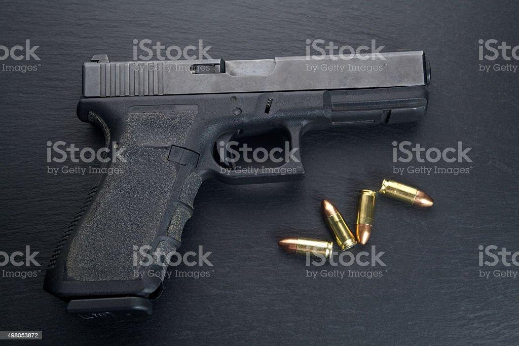 Pistol gun on black background stock photo