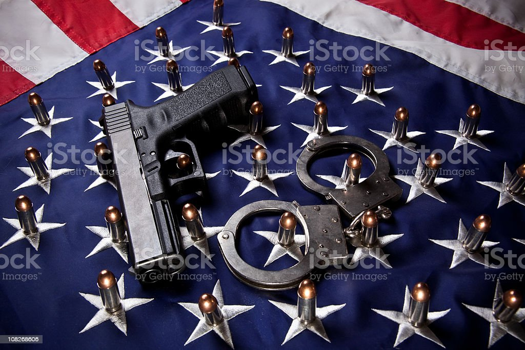 Pistol, handcuffs, bullets and flag (horizontal) stock photo