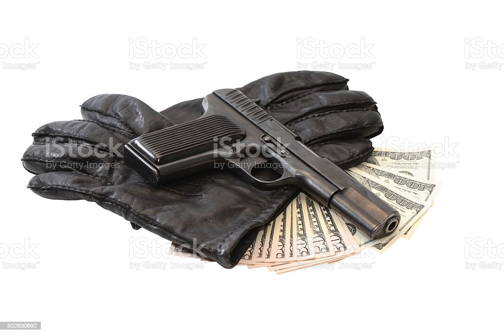 Pistol On Gloves And Money stock photo