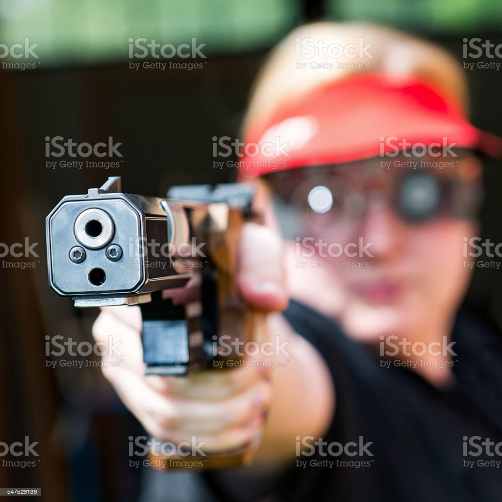 Pistol shooting, professional competitor stock photo