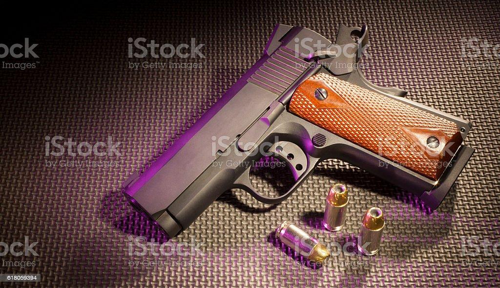Pistol with cartridges stock photo