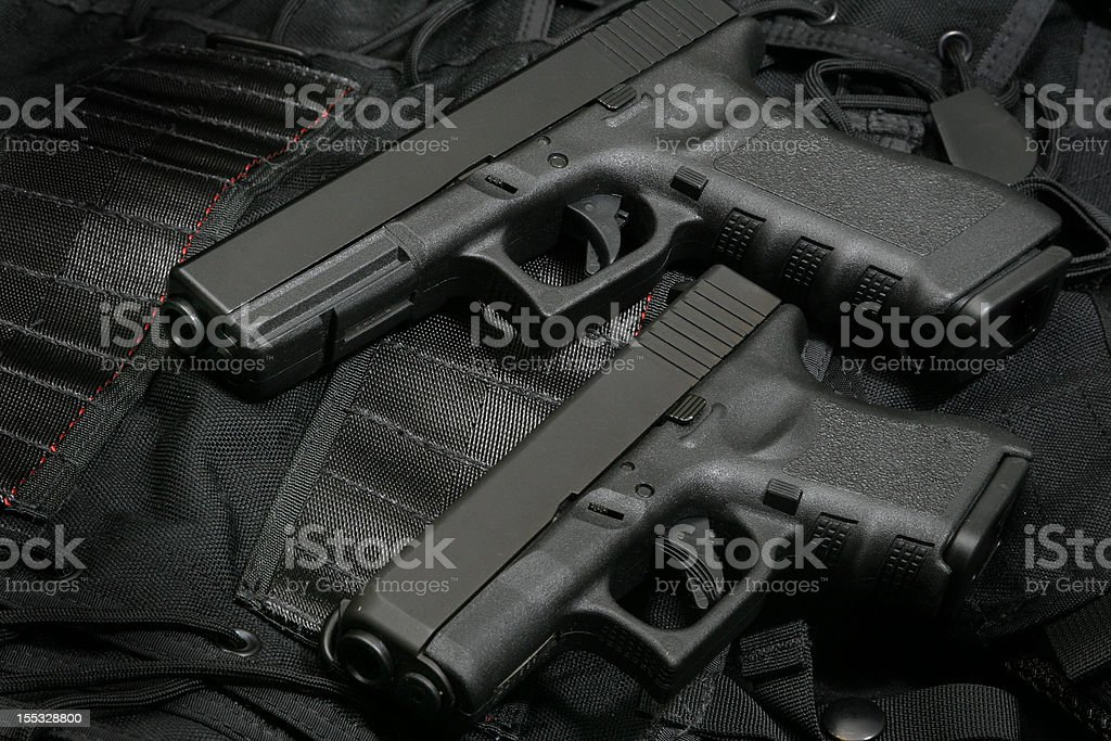 Pistol with smaller twin royalty-free stock photo