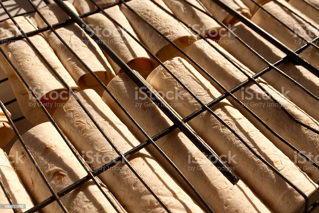 Pita bread rolls on grill bar. stock photo