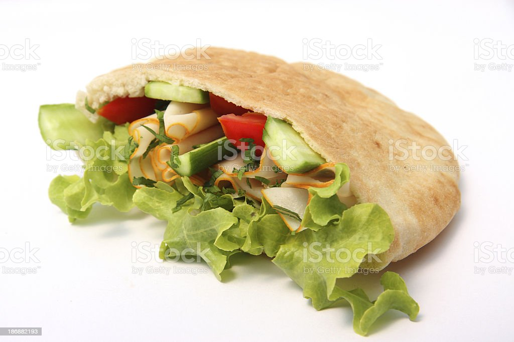 Pita bread stuffed by turkey pastrami and fresh salad stock photo