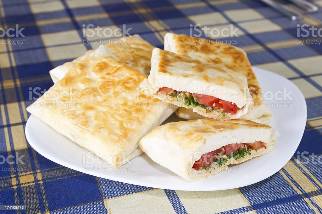 Pita bread with cheese, tomato and herbs royalty-free stock photo