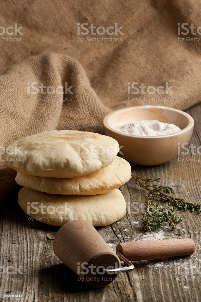 Pita bread with flour stock photo