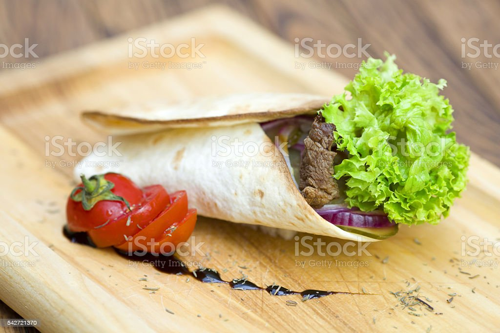 Pita bread with ham and fresh vegetables stock photo