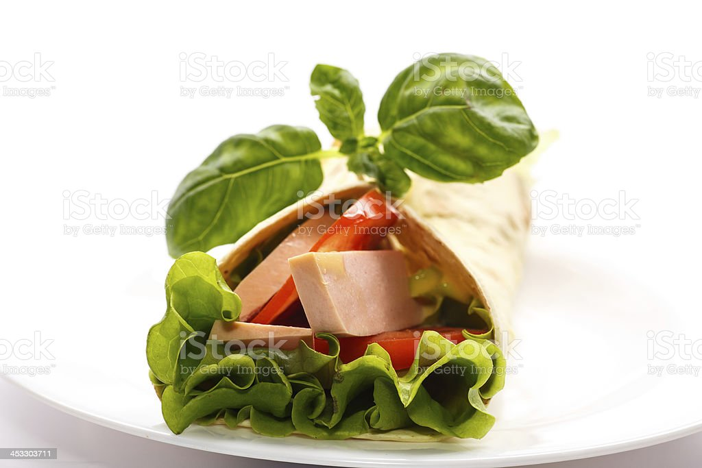pita bread with lettuce, salami and tomatoes royalty-free stock photo
