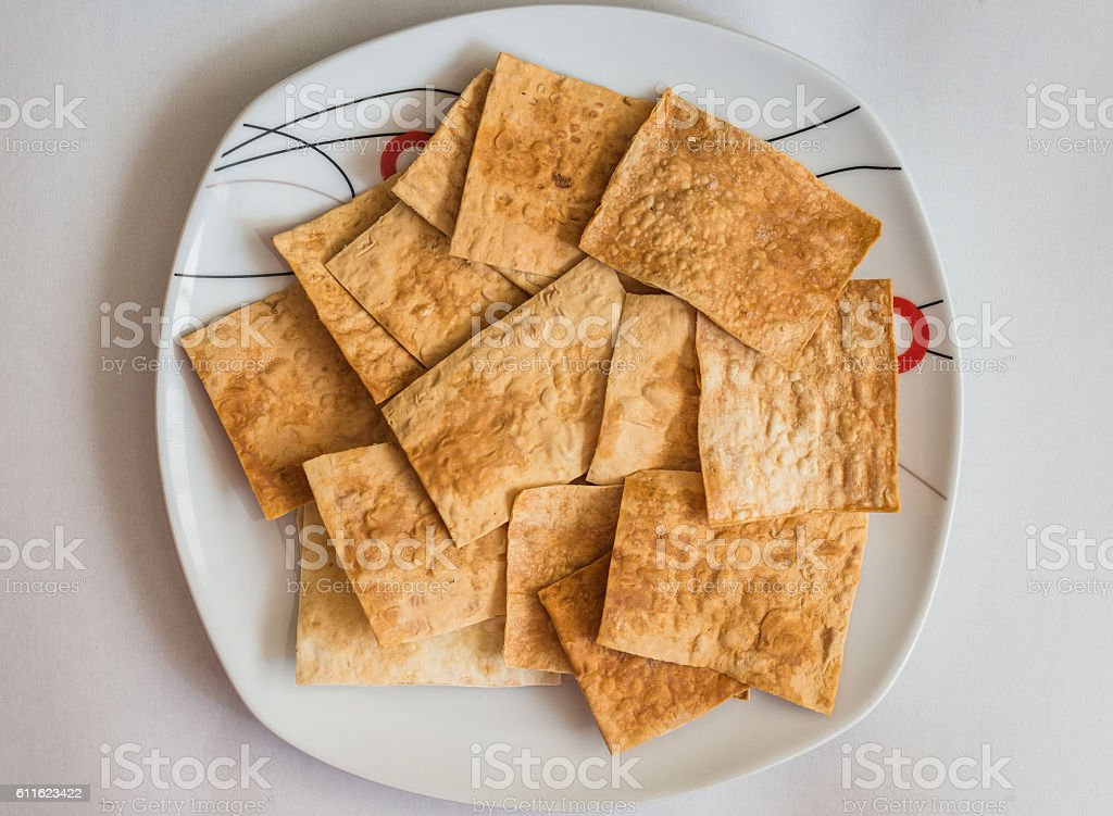 pita chips in white plate stock photo