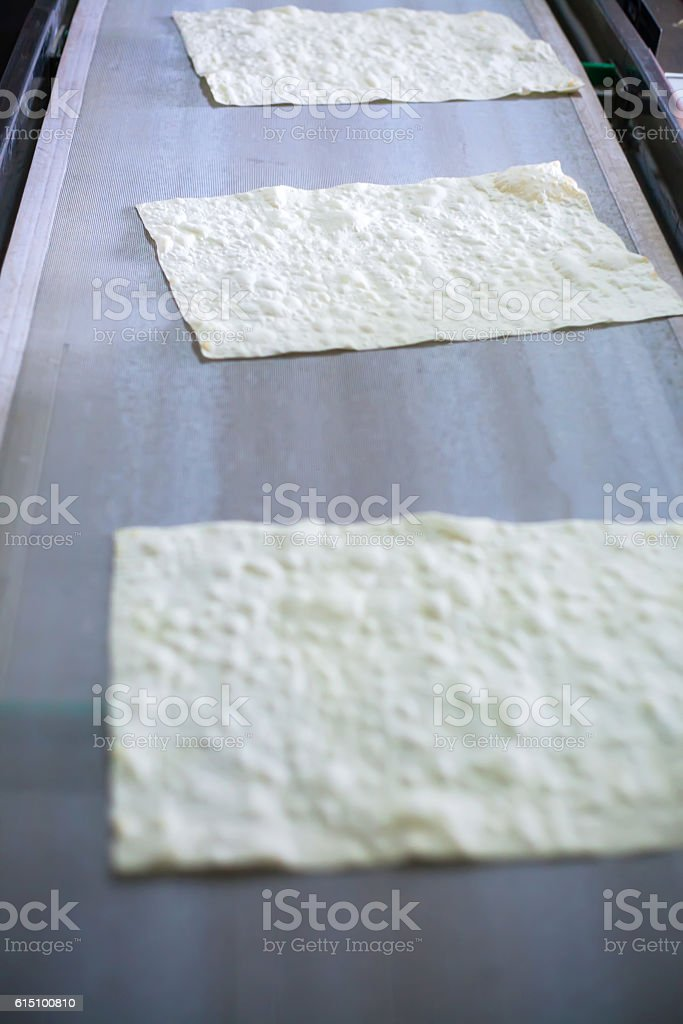 Pita on the production line at the bakery royalty-free stock photo