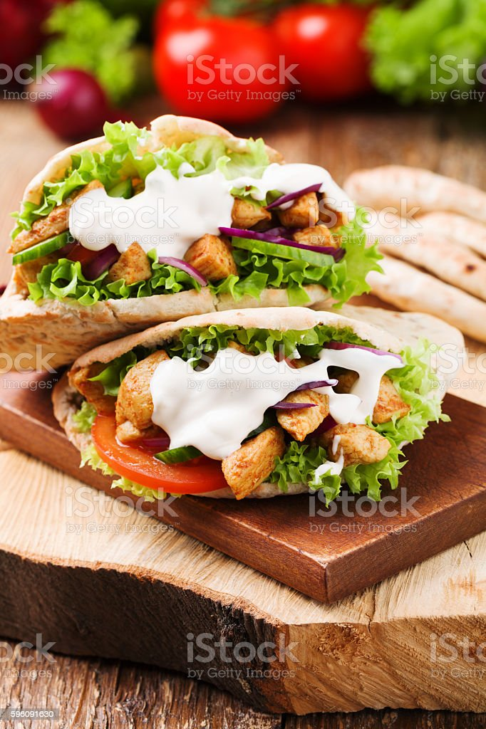 Pita salad with roasted chicken and vegetables. stock photo