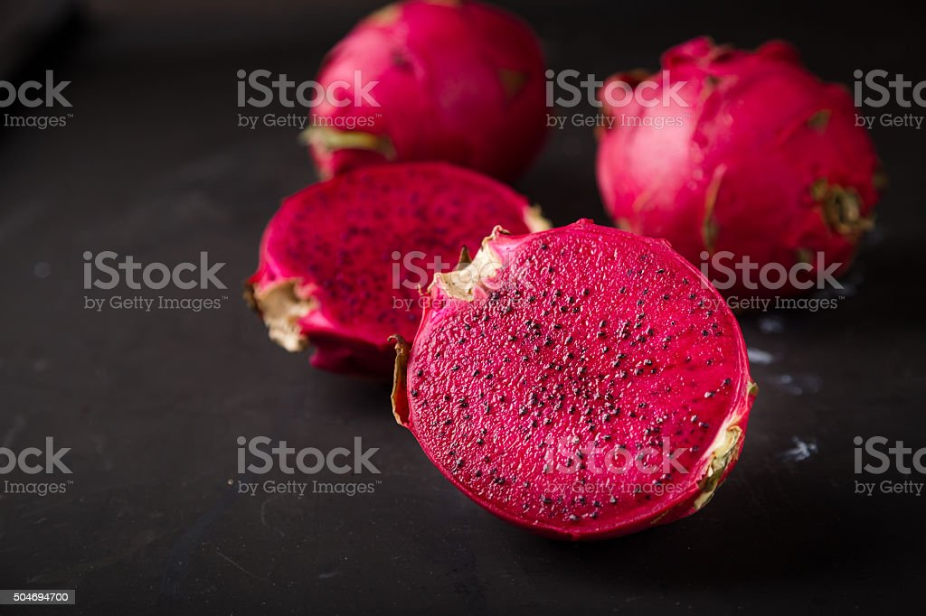 Pitaya cut in half on black background stock photo