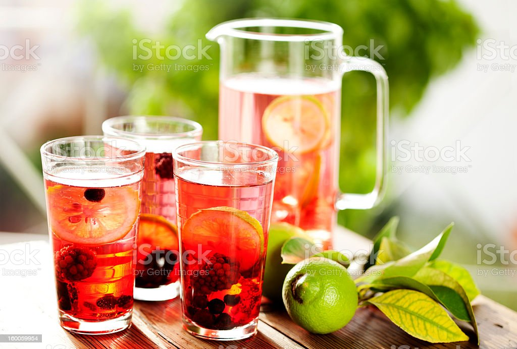Pitcher and glasses full of fresh berry lemonade stock photo