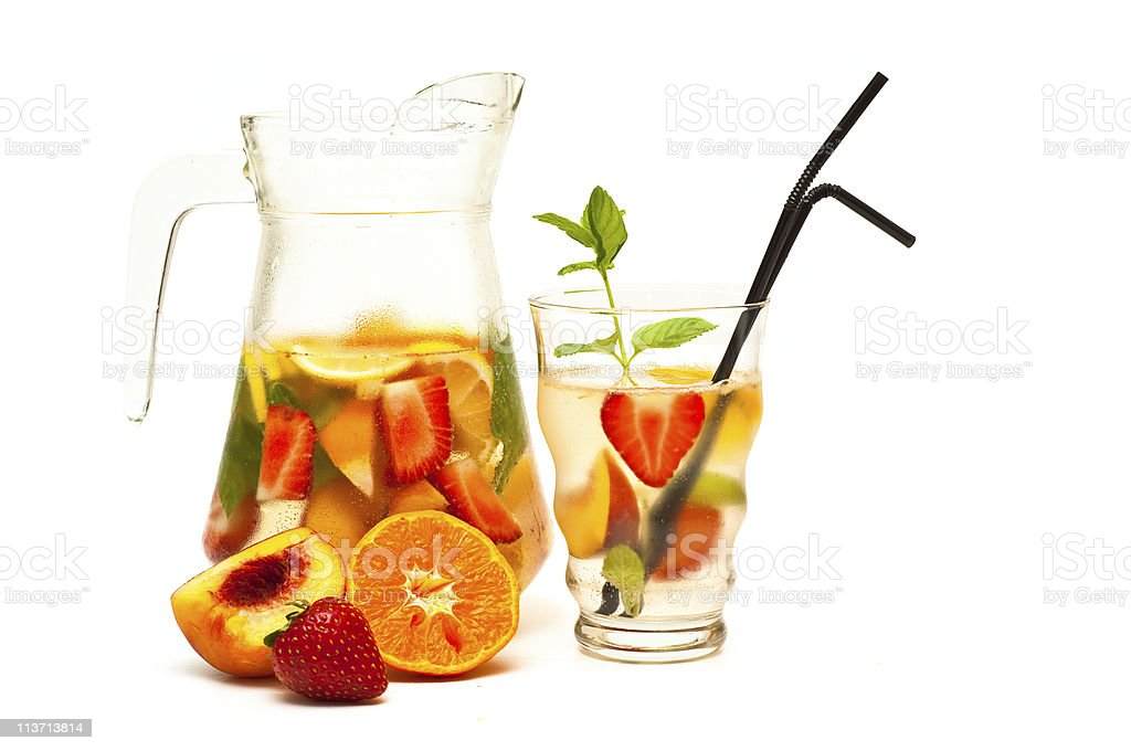 A pitcher of refreshing fruit cocktails with real fruits royalty-free stock photo
