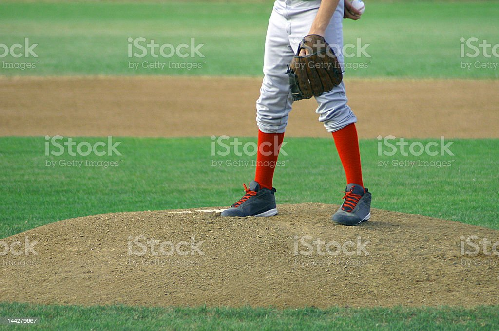 Pitcher standing on mound waiting to pitch a ball stock photo