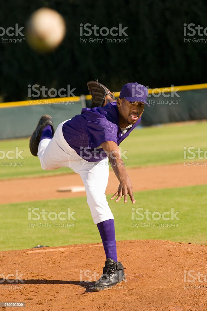 Pitcher Throwing Baseball Towards Batter stock photo