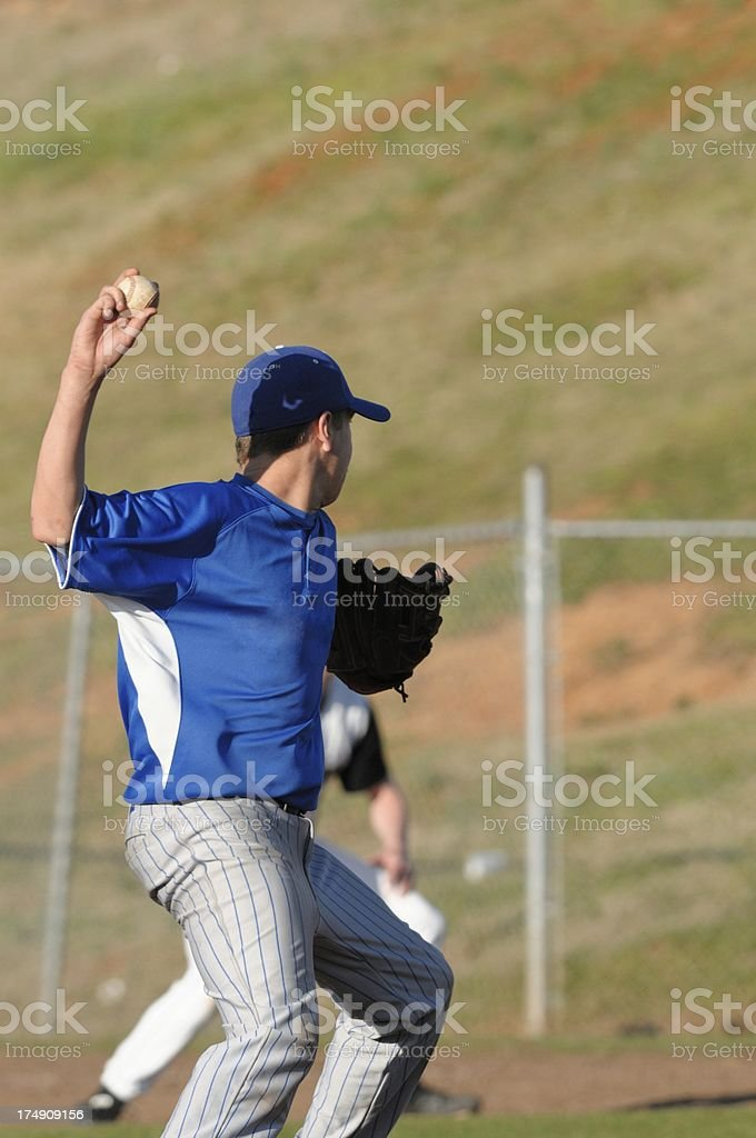 Pitcher throwing to first stock photo