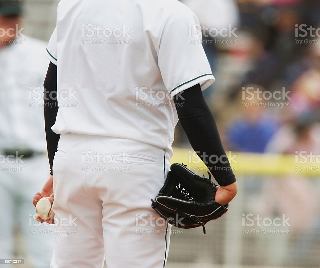 Pitcher Waits for Signal royalty-free stock photo