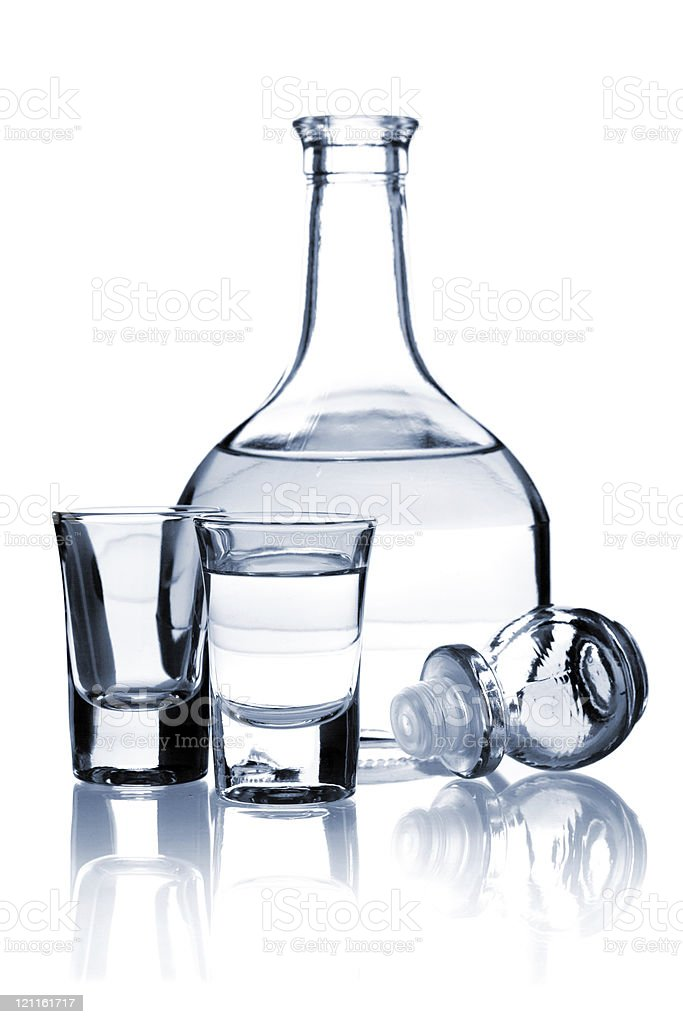 Pitcher with vodka and two shots royalty-free stock photo