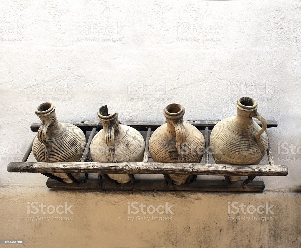 Pitchers on stucco wall royalty-free stock photo