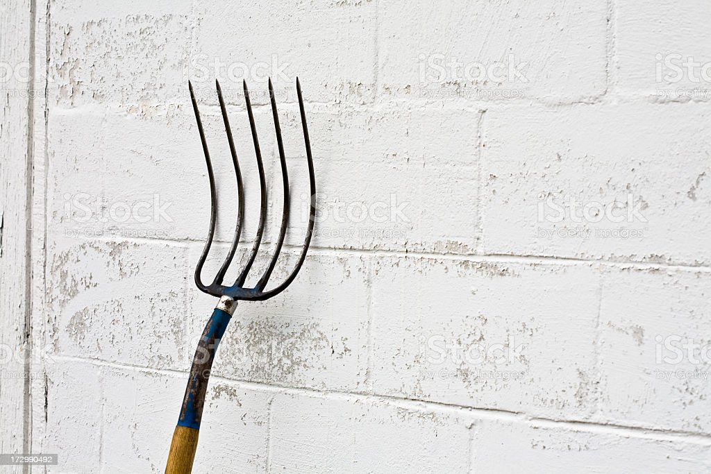 Pitchfork on White Wall stock photo