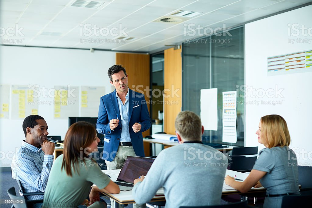 Pitching his ideas to the team stock photo
