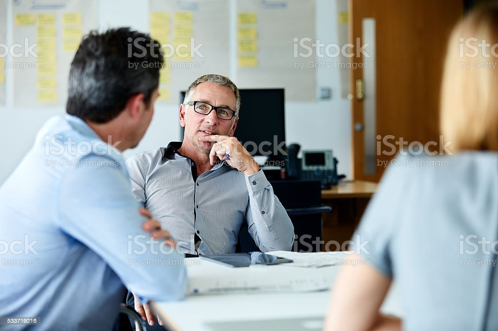 Pitching their ideas to the boss stock photo