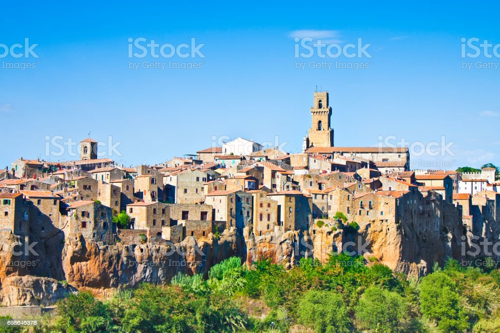 Pitigliano, Italian etruscan and medieval village built of tufa stone - Called 'little Jerusalem' for the historical presence of a Jewish community - (Tuscany - Italy) - toned image stock photo