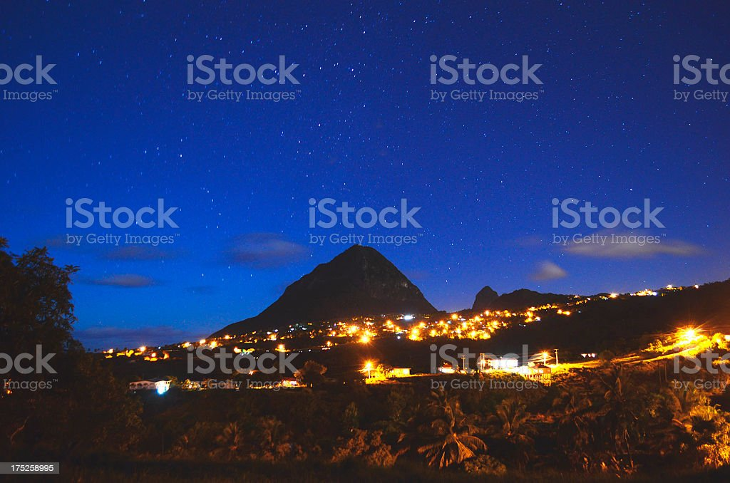 Piton at night under stars from Choiseul St Lucia stock photo