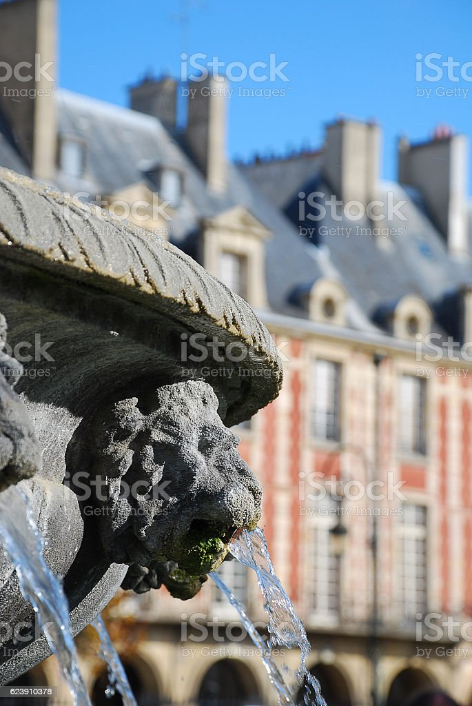Pitoresque fountain at Place des Vosges stock photo