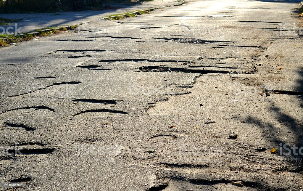 pits on the roads of asphalt stock photo