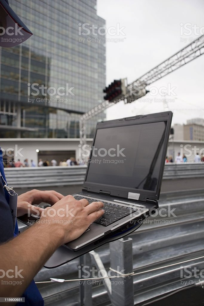 Pitstop laptop guy stock photo