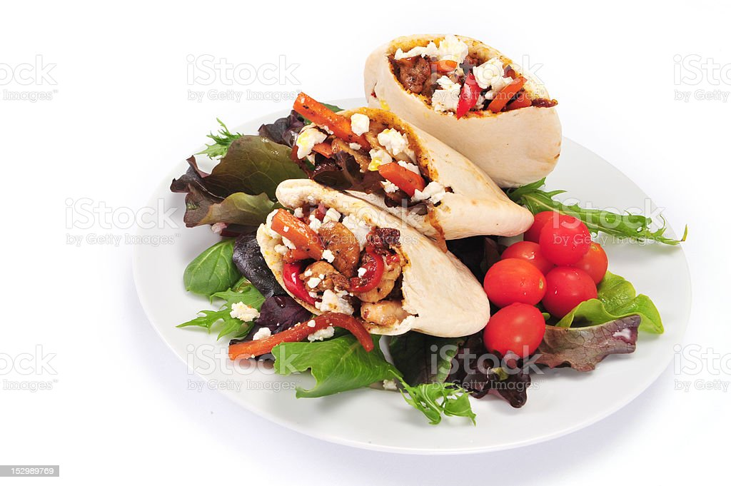 Pitta bread filled with a chicken and vegetables royalty-free stock photo