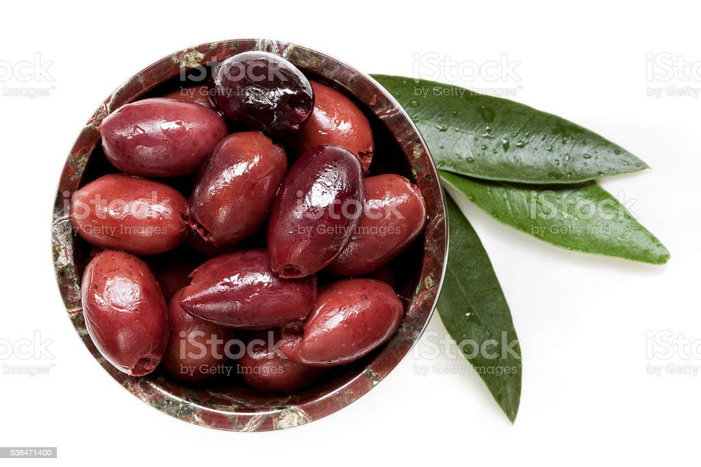 Pitted Black Kalamata Olives with Leaves Top View stock photo