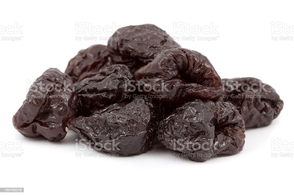 Pitted dried prunes in a bunch stock photo