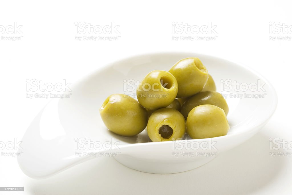 Pitted olives in dish stock photo